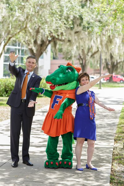 UF College of Medicine dean Michael L. Good, M.D., and UF College of Nursing dean Anna McDaniel, Ph.D., R.N., pose with Gators mascot Alberta at the colleges' 60th anniversary barbecue. Photo by Mindy C. Miller